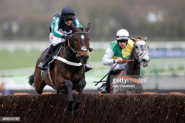 Nico de Boinville ridng Altior clear the last to win The Racing Post Arkle Challenge Trophy Novices Steeple Chase at Cheltenham racecourse on day one...