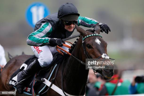 Nico de Boinville ridng Altior clear the last to win The Racing Post Arkle Challenge Trophy Novices' Steeple Chase at Cheltenham racecourse on day...