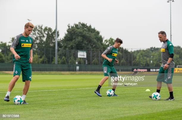 Nico Elvedi and Jonas Hofmann during a training session of Borussia Moenchengladbach at BorussiaPark on June 27 2017 in Moenchengladbach Germany