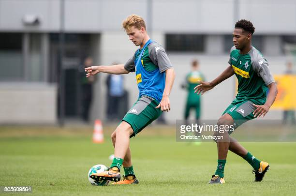 Nico Elvedi is chased by Reece Oxford during a training session of Borussia Moenchengladbach at BorussiaPark on July 02 2017 in Moenchengladbach...