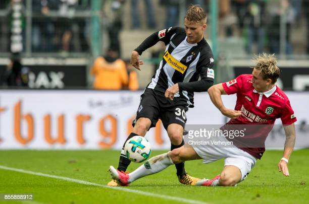 Nico Elvedi of Borussia Moenchengladbach and Matthias Ostrzolek of Hannover 96 battle for the ball during the Bundesliga match between Borussia...