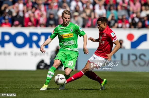 Nico Elvedi of Borussia Moenchengladbach and Robin Quaison of FSV Mainz 05 battle for the ball during the Bundesliga Match between 1FSV Mainz 05 and...