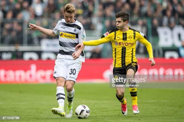 Nico Elvedi of Borussia Moenchengladbach is chased by Mikel Merino of Borussia Dortmund during the Bundesliga Match between Borussia Moenchengladbach...