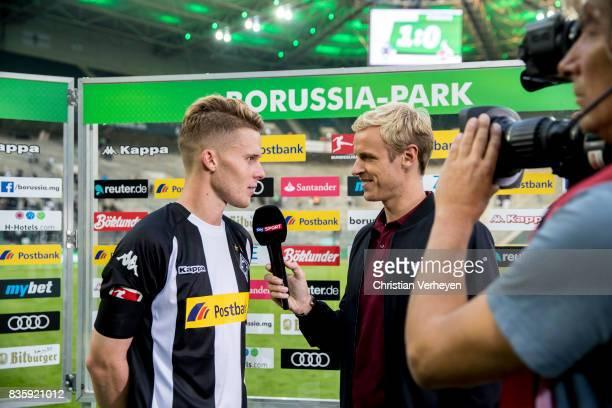 Nico Elvedi of Borussia Moenchengladbach speaks to the media after the Bundesliga match between Borussia Moenchengladbach and 1 FC Koeln at...
