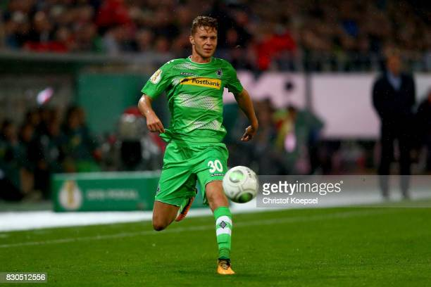 Nico Elvedi of Mnchengladbach runs with the ball during the DFB Cup first round match between RotWeiss Essen and Borussia Moenchengladbach at Stadion...