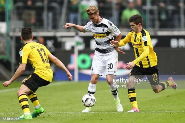 Nico Elvedi of Moenchengladbach and Christian Pulisic of Dortmund battle for the ball during the Bundesliga match between Borussia Moenchengladbach...