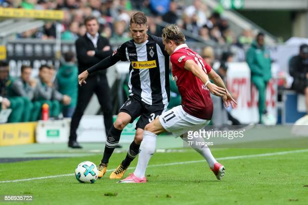 Nico Elvedi of Moenchengladbach and Felix Klaus of Hannover battle for the ball during the Bundesliga match between Borussia Moenchengladbach and...