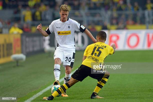 Nico Elvedi of Moenchengladbach and Jeremy Toljan of Dortmund battle for the ball during the Bundesliga match between Borussia Dortmund and Borussia...