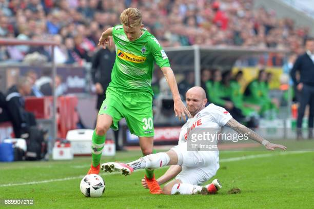 Nico Elvedi of Moenchengladbach and Konstantin Rausch of Koeln battle for the ball during the Bundesliga Match between 1FC Koeln and Borussia...