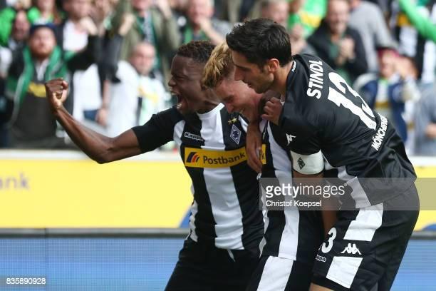 Nico Elvedi of Moenchengladbach celebrates having scored his teams first goal with Ibrahima Traore of Moenchengladbach and Lars Stindl of...