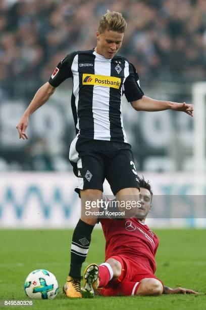 Nico Elvedi of Moenchengladbach fights for the ball with Anastasios Donis of Stuttgart during the Bundesliga match between Borussia Moenchengladbach...