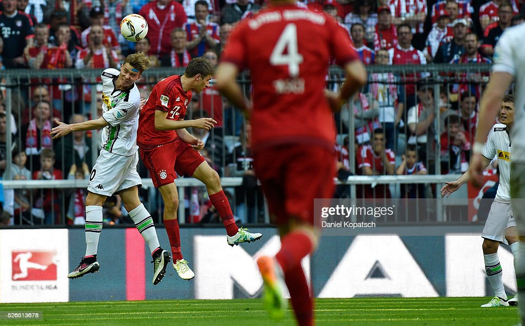 Nico Elvedi of Moenchengladbach (L) jumps for a header with Thomas Mueller of Muenchen during the Bundesliga match between FC Bayern Muenchen and Borussia Moenchengladbach at Allianz Arena on April 30, 2016 in Munich, Germany.