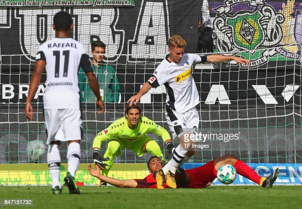 Nico Elvedi of Moenchengladbach Simon Falette of Frankfurt and Yann Sommer of Moenchengladbach battle for the ball during the Bundesliga match...