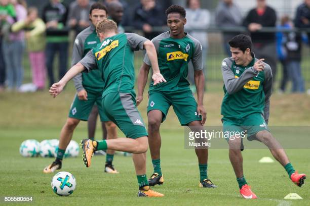 Nico Elvedi Reece Oxford and Vincenzo Grifo battle for the ball during Training Session on July 2 2017 in Moenchengladbach Germany