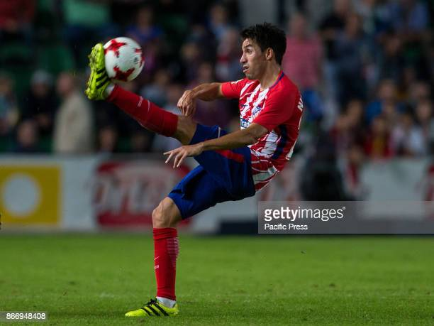 Nico Gaitan control the ball during the Spanish Copa del Rey round of 32 first league football match between Elche CF and Atletico de Madrid at the...