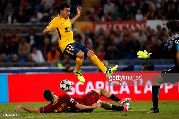 Nico Gaitan of Atletico Madrid and Kostas Manolas of Rom battle for the ball during the UEFA Champions League group C match between AS Roma and...
