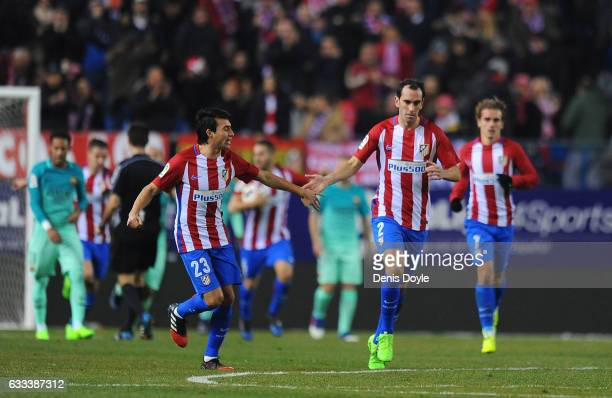 Nico Gaitan of Club Atletico de Madrid reacts with Diego Godin after scoring their opening goal during the Copa del Rey Semifinal First Leg match...