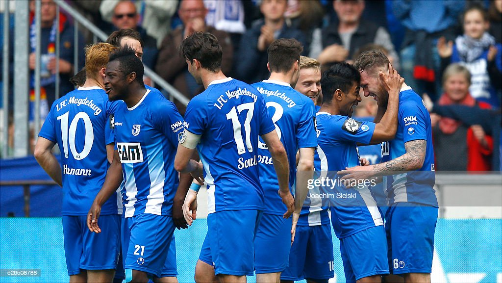 Nico Hammann, David Kinsombi, Marius Sowislo, Steffen Puttkammer, Nils Butzen, Ahmed Waseem Razeek and Goalgetter Jan Loehmannsroeben of Magdeburg celebration the goal 4:0 for Magdeburg during the Third League match between 1. FC Magdeburg and SG Sonnenhof-Grosssaspach at MDCC-Arena on April 30, 2016 in Magdeburg, Germany.