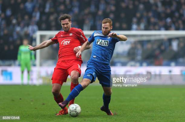 Nico Hammann of Magdeburg and Ronny Koenig of Zwickau vie during the Third League match between 1 FC Magdeburg and FSV Zwickau at MDCC Arena on...