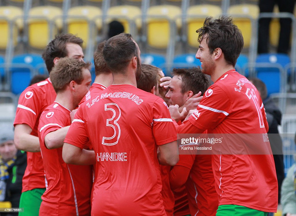 Nico Hammann of Magdeburg celebrates the opening goal with teammates during the Regionalliga match between FC Carl Zeiss Jena and 1.FC Magdeburg at Ernst Abbe Sportfeld on March 16, 2014 in Jena, Germany.