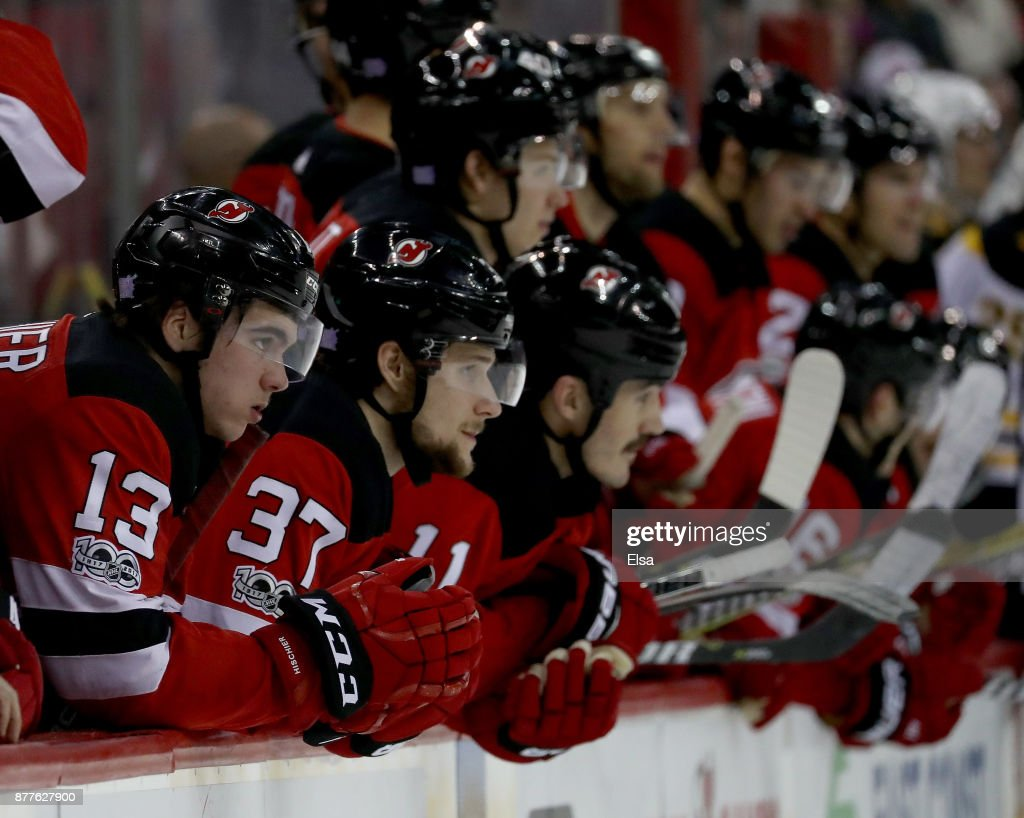 Nico Hischier #13 and Pavel Zacha #37 of the New Jersey Devils watch the shootout with the rest of their teammates on November 22, 2017 at Prudential Center in Newark, New Jersey.The Boston Bruins defeated the New Jersey Devils 3-2 in an overtime shootout.
