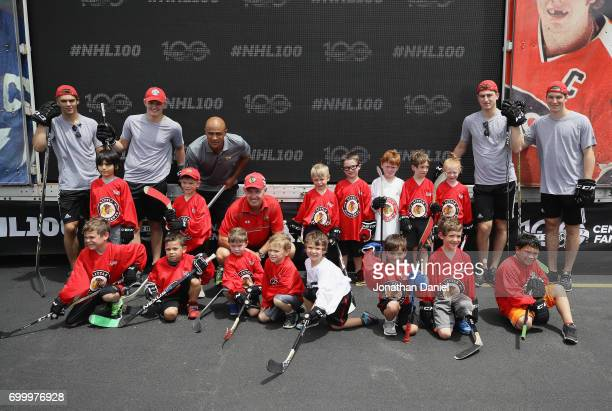 Nico Hischier Casey Mittelstadt Jamal Mayers Denis Savard Gabriel Vilardi and Nolan Patrick pose with children after the 2017 NHL Draft top prospects...