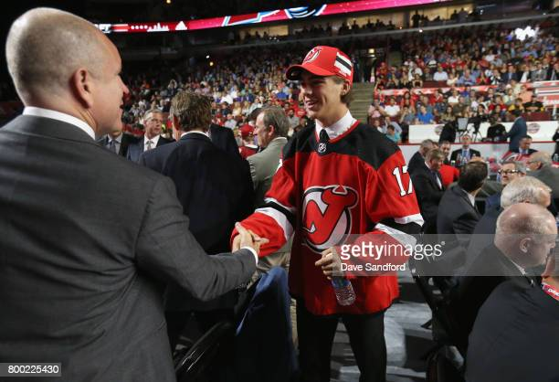 Nico Hischier first overall pick by the New Jersey Devils greets the team during Round One of the 2017 NHL Draft at United Center on June 23 2017 in...