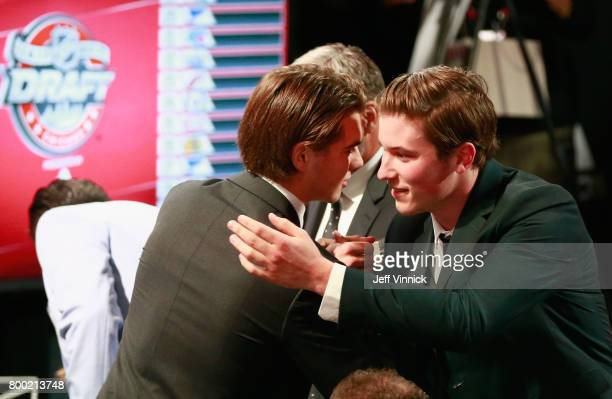 Nico Hischier first overall pick of the New Jersey Devils is congratulated by Nolan Patrick second overall pick of the Philadelphia Flyers during...