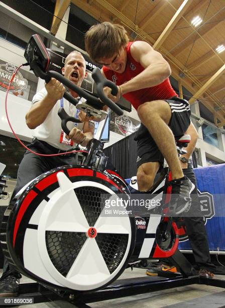 Nico Hischier is encouraged by Jordan Marwin on the Wingate Cycle during the NHL Combine at HarborCenter on June 3 2017 in Buffalo New York
