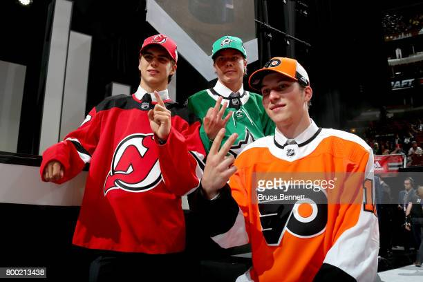 Nico Hischier Miro Heiskanen and Nolan Patrick pose for photos after being selected during the 2017 NHL Draft at the United Center on June 23 2017 in...