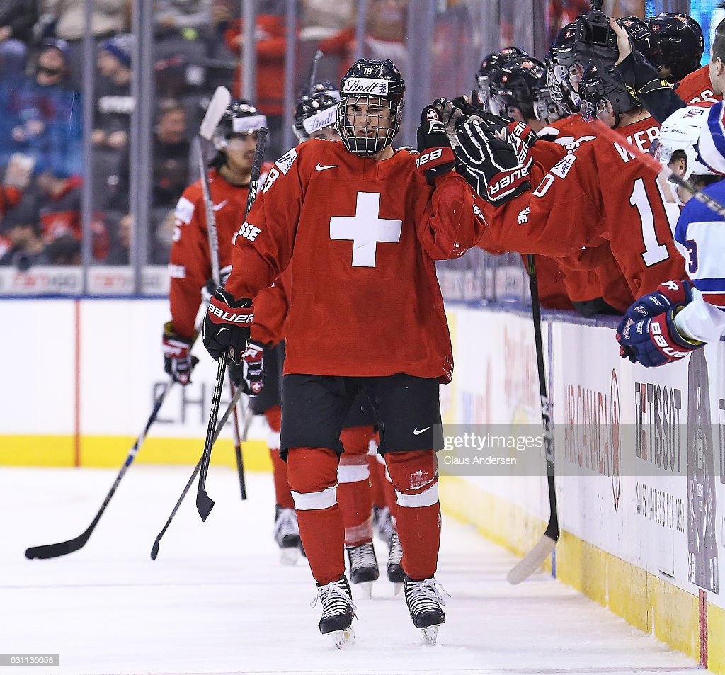 Nico Hischier #18 of Team Switzerland celebrates a goal against Team USA during a QuarterFinal game at the 2017 IIHF World Junior Hockey Championships at Air Canada Centre on January 2, 2017 in Toronto, Ontario, Canada. Team USA defeated Team Switzerland 3-2.