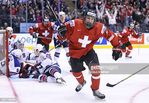 Nico Hischier of Team Switzerland celebrates one of his 2 goals against Team USA during a QuarterFinal game at the 2017 IIHF World Junior Hockey...