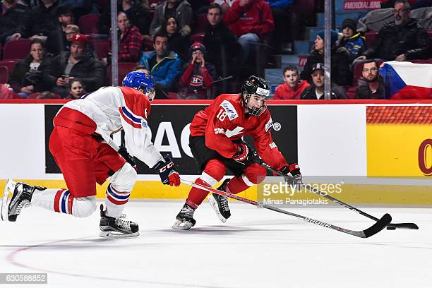 Nico Hischier of Team Switzerland skates the puck against Ondrej Vala of Team Czech Republic during the IIHF World Junior Championship preliminary...