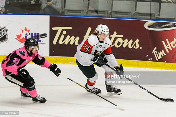 Nico Hischier of the Halifax Mooseheads skates the puck against Pascal Corbeil of the BlainvilleBoisbriand Armada during the QMJHL game at the Centre...