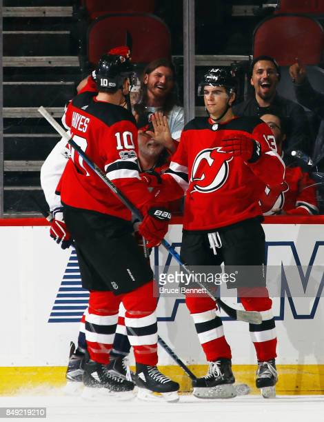 Nico Hischier of the New Jersey Devils celebrtaes his third period goal against the Washington Capitals and is joined by Jimmy Hayes during a...