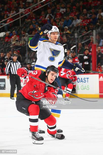 Nico Hischier of the New Jersey Devils skates against Colton Parayko of the St Louis Blues during the game at Prudential Center on November 7 2017 in...