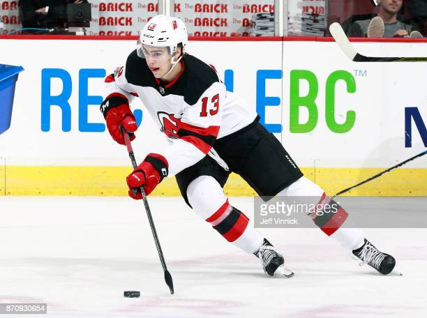 Nico Hischier of the New Jersey Devils skates up ice during their NHL game against the Vancouver Canucks at Rogers Arena November 1 2017 in Vancouver...