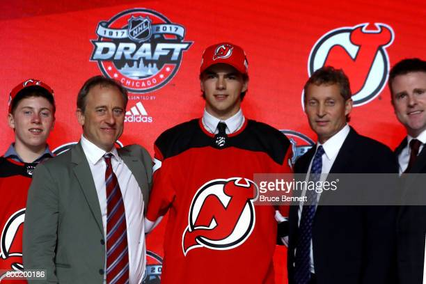 Nico Hischier poses for photos after being selected first overall by the New Jersey Devils during the 2017 NHL Draft at the United Center on June 23...
