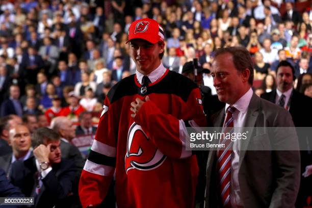 Nico Hischier walks off the floor after being selected first overall by the New Jersey Devils during the 2017 NHL Draft at the United Center on June...