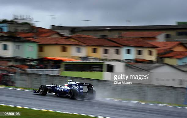 Nico Huelkenberg of Germany and Williams drives on his way to finishing first during qualifying for the Brazilian Formula One Grand Prix at the...