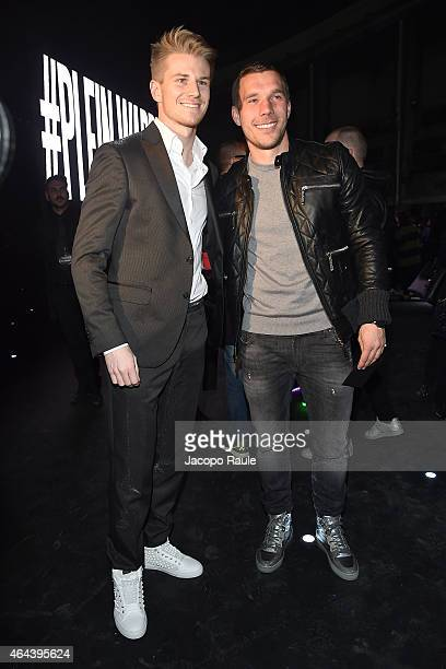 Nico Hulkenberg and Lukas Podolski attend the Philipp Plein show during the Milan Fashion Week Autumn/Winter 2015 on February 25 2015 in Milan Italy