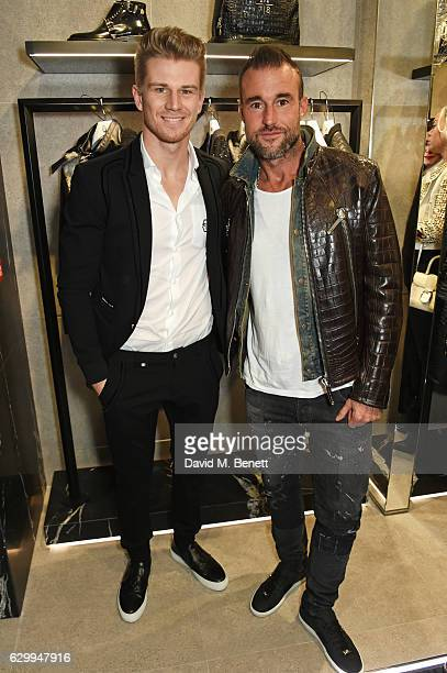 Nico Hulkenberg and Philipp Plein attend a cocktail party hosted by Philipp Plein to celebrate the opening of the Philipp Plein London boutique on...