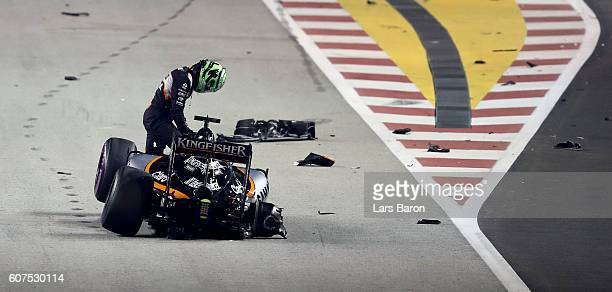 Nico Hulkenberg of Germany and Force India climbs out of his car after crashing at the start during the Formula One Grand Prix of Singapore at Marina...