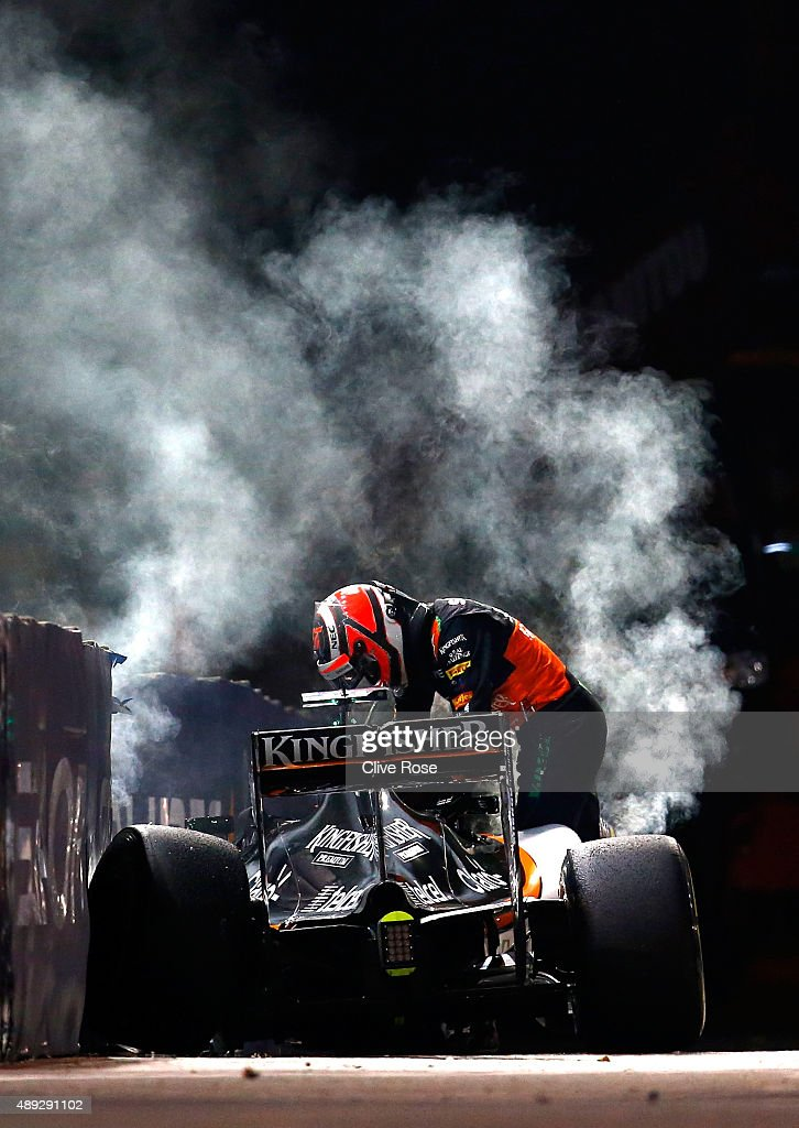 Nico Hulkenberg of Germany and Force India climbs out of his car after crashing during the Formula One Grand Prix of Singapore at Marina Bay Street Circuit on September 20, 2015 in Singapore.