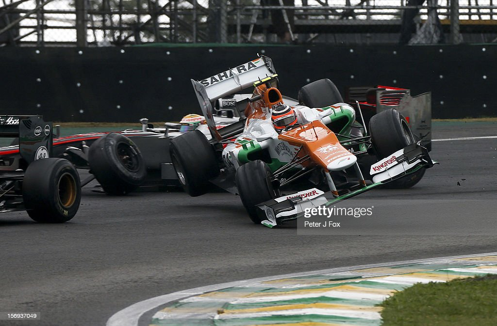 <a gi-track='captionPersonalityLinkClicked' href=/galleries/search?phrase=Nico+Hulkenberg&family=editorial&specificpeople=2566799 ng-click='$event.stopPropagation()'>Nico Hulkenberg</a> Of Germany and Force India crashes into <a gi-track='captionPersonalityLinkClicked' href=/galleries/search?phrase=Lewis+Hamilton+-+Racecar+Driver&family=editorial&specificpeople=586983 ng-click='$event.stopPropagation()'>Lewis Hamilton</a> of Great Britain and McLaren during the Brazilian Formula One Grand Prix at the Autodromo Jose Carlos Pace on November 25, 2012 in Sao Paulo, Brazil.