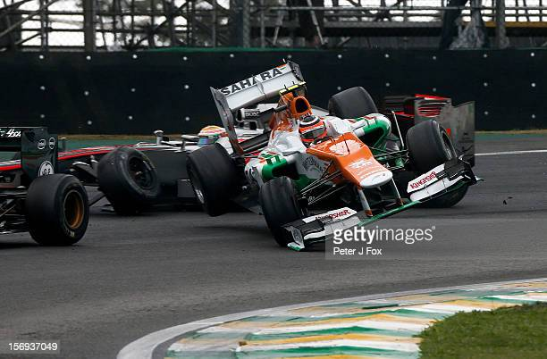 Nico Hulkenberg Of Germany and Force India crashes into Lewis Hamilton of Great Britain and McLaren during the Brazilian Formula One Grand Prix at...