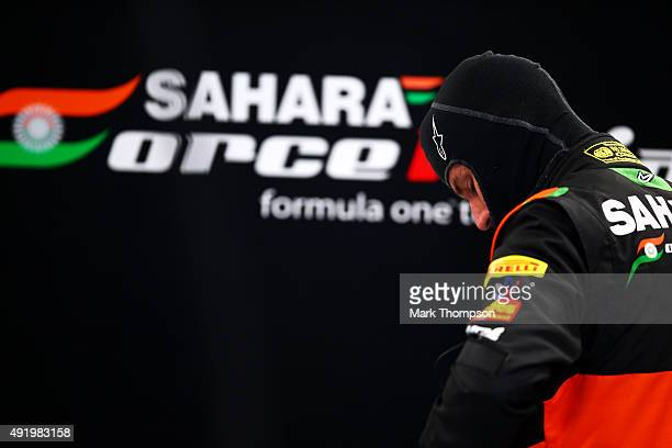 Nico Hulkenberg of Germany and Force India prepares in the garage during practice for the Formula One Grand Prix of Russia at Sochi Autodrom on...