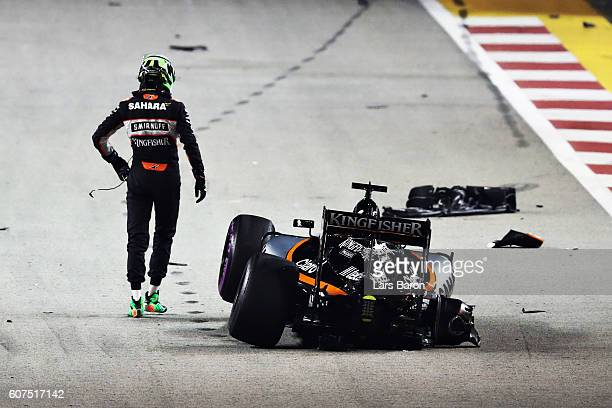 Nico Hulkenberg of Germany and Force India walks way from his car after crashing during the Formula One Grand Prix of Singapore at Marina Bay Street...