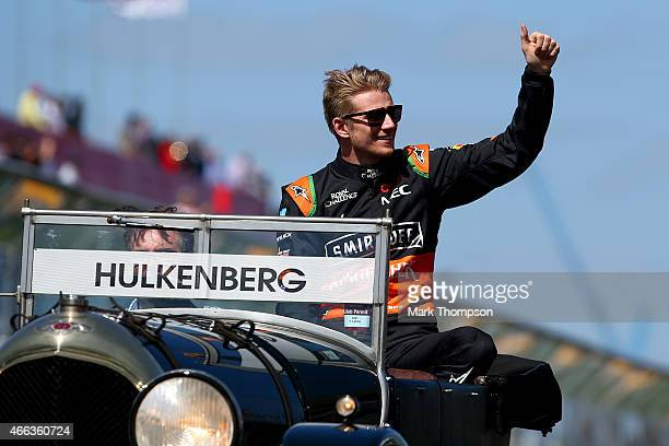Nico Hulkenberg of Germany and Force India waves to the fans during the drivers' parade before the Australian Formula One Grand Prix at Albert Park...