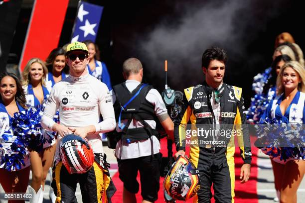 Nico Hulkenberg of Germany and Renault Sport F1 and Carlos Sainz of Spain and Renault Sport F1 walk to the grid before the United States Formula One...